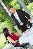 Man pouring wine to ladys glass Royalty Free Stock Image