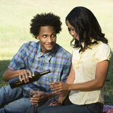 Man pouring woman wine. Royalty Free Stock Image