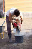 Man pours a bag of cement in bucket Royalty Free Stock Photography