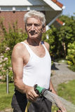 Man pours his garden Royalty Free Stock Images
