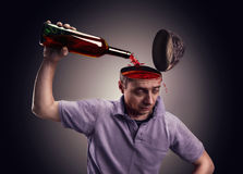 Man pours his head on with alcohol stock photos