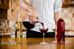 Man pours red wine royalty free stock photo