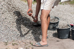 A man pours shovel the gravel Royalty Free Stock Photo