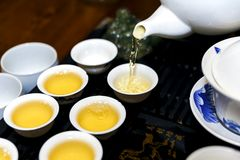 A man pours tea during a tea ceremony Stock Photography
