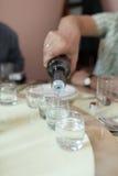 Man pours vodka Royalty Free Stock Photography