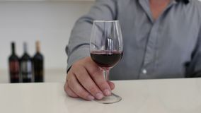 A man pours wine from a bottle into a glass 4k stock video