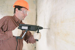 Man with power drill. Construction worker with power drill Royalty Free Stock Photos