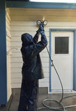 Man power washing a home. Royalty Free Stock Photography