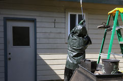 Man power washing a home. Stock Photo
