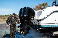 Free Man Power Washing Outboard Motors Stock Photo - 160409800