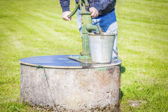 Man powered water pump Royalty Free Stock Photography