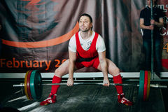 Man powerlifter attempt deadlift heavy barbell Royalty Free Stock Photography