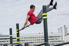 Man practice street workout. Moscow, Russia - September 10, 2016: Young man practice street workout on open competition dedicated to City Day Royalty Free Stock Photo