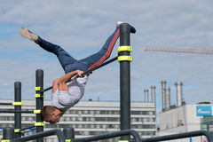 Man practice street workout. Moscow, Russia - September 10, 2016: Young man practice street workout on open competition dedicated to City Day Royalty Free Stock Photography
