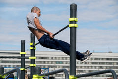 Man practice street workout. Moscow, Russia - September 10, 2016: Young man practice street workout on open competition dedicated to City Day Royalty Free Stock Photos