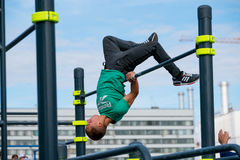 Man practice street workout. Moscow, Russia - September 10, 2016: Young man practice street workout on open competition dedicated to City Day Royalty Free Stock Image