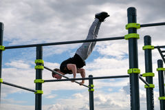 Man practice street workout. Moscow, Russia - September 10, 2016: Young man practice street workout on open competition dedicated to City Day Stock Image