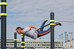 Man practice street workout. Moscow, Russia - September 10, 2016: Young man practice street workout on open competition dedicated to City Day Stock Images
