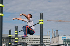 Man practice street workout. Moscow, Russia - September 10, 2016: Young man practice street workout on open competition dedicated to City Day Stock Photography