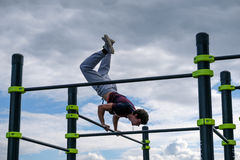 Man practice street workout. Moscow, Russia - September 10, 2016: Young man practice street workout on open competition dedicated to City Day Stock Photo