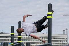 Man practice street workout. Moscow, Russia - September 10, 2016: Young man practice street workout on open competition dedicated to City Day Stock Photos