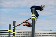 Man practice street workout. Moscow, Russia - September 10, 2016: Young man practice street workout on open competition dedicated to City Day Royalty Free Stock Images
