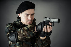 Man practiced in improving shooting Stock Image