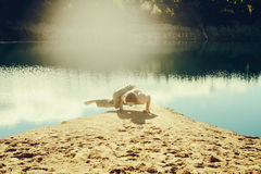 Man practices asanas on yoga in harmony with nature Stock Photo