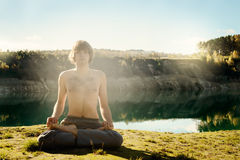 Man practices asanas on yoga in harmony with nature Stock Photography