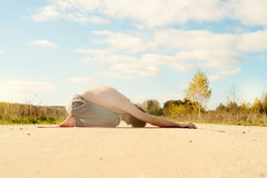 Man practices asanas on yoga in harmony with nature Royalty Free Stock Images