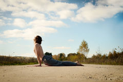 Man practices asanas on yoga in harmony with nature Stock Images