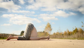 Man practices asanas on yoga in harmony with nature Royalty Free Stock Photography