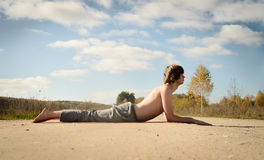 Man practices asanas on yoga in harmony with nature Stock Photos