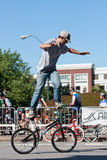 Man Practices Flatland Bike Tricks Before BMX Competition Royalty Free Stock Image