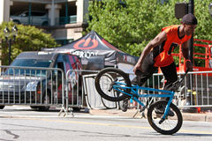 Man Practices Flatland BMX Tricks Before Competition Stock Photography