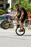 Man Practices Riding Bike Backwards Before BMX Contest Royalty Free Stock Images