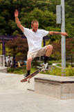 Man Practices Skateboard Trick At Park. Atlanta, GA, USA - June 29, 2013:  A young man practices a skateboard trick at the Old Fourth Ward Skateboard Park in Royalty Free Stock Photo