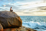 Man practices yoga on coast - meditation Stock Photography