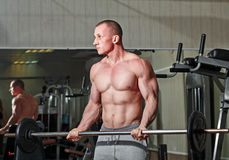 Man practicing with barbell in gym Royalty Free Stock Image