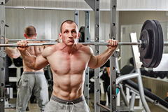 Man practicing with barbell in gym Royalty Free Stock Photography