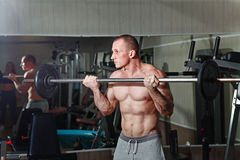 Man practicing with barbell in gym Stock Photo