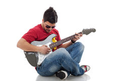 Man practicing on electric guitar royalty free stock photography