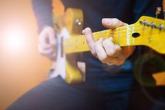 Man practicing electric guitar playing. Guitar lesson stock image