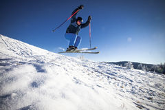 Man practicing extreme ski. On sunny day Royalty Free Stock Images