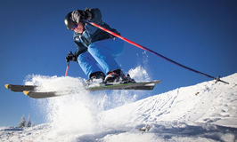 Man practicing extreme ski. On sunny day Royalty Free Stock Photos