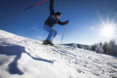 Man practicing extreme ski. On sunny day Royalty Free Stock Photo