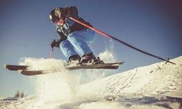 Man practicing extreme ski. On sunny day royalty free stock image