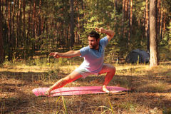 Man practicing martial arts outdoors in the forest Stock Photo