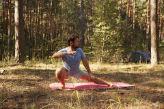 Man practicing martial arts outdoors in the forest Stock Photography
