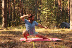 Man practicing martial arts outdoors in the forest Royalty Free Stock Photography